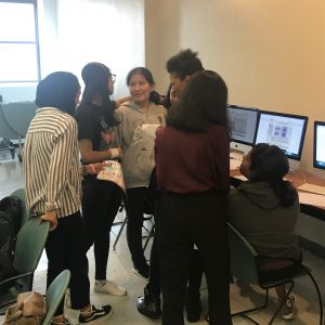 Girls gather around Professor Hendryx